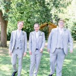 Pale Grey Moss Bros Groomsman Lilac & Grey table linen Summer Wedding Millbridge Court Surrey